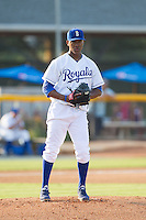 Burlington Royals starting pitcher Carlos Herrera (43) checks the runner on first base during the game against the Johnson City Cardinals at Burlington Athletic Park on July 14, 2014 in Burlington, North Carolina.  The Cardinals defeated the Royals 9-4.  (Brian Westerholt/Four Seam Images)