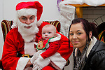 Baby Callum Clail visits Santa in his grotto with Sinead Clarke at the Youthreach Party..Picture: Shane Maguire / www.newsfile.ie.