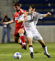 Chicago Fire defender Gonzalo Segares (25) and DC United midfielder Joshua Gros (17) battle for the ball.  The Chicago Fire defeated the DC United 3-0 in the semifinals of the U.S. Open Cup at Toyota Park in Bridgeview, IL on September 6, 2006...