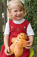 Girl with Weckeman a traditional German Baked Goo
