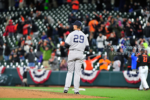 New York Yankees relief pitcher Tyler Clippard (29) looks into right field after Baltimore Orioles right fielder Seth Smith (12) connected for the game-winning 2 run home run in the seventh inning at Oriole Park at Camden Yards in Baltimore, MD on Friday, April 7, 2017.  The Orioles won the game 6 - 5.<br /> Credit: Ron Sachs / CNP<br /> (RESTRICTION: NO New York or New Jersey Newspapers or newspapers within a 75 mile radius of New York City)