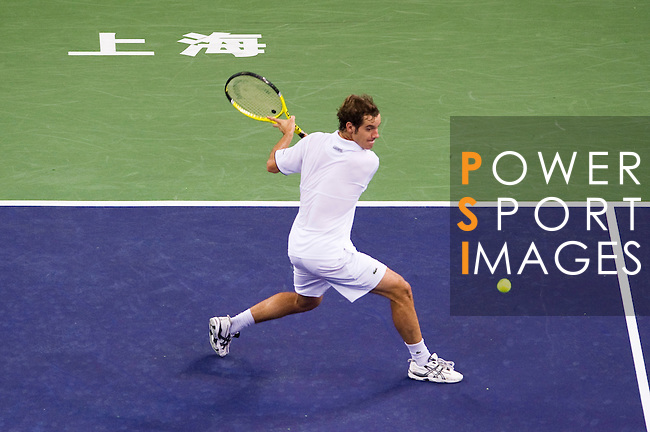 SHANGHAI, CHINA - OCTOBER 14:  Richard Gasquet of France returns a ball to Novak Djokovic of Serbia during day four of the 2010 Shanghai Rolex Masters at the Shanghai Qi Zhong Tennis Center on October 14, 2010 in Shanghai, China.  (Photo by Victor Fraile/The Power of Sport Images) *** Local Caption *** Richard Gasquet