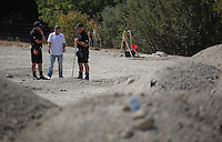 Pictured: Eddie Needham (2ND LEFT), the grandfather of missing Ben Needham, is shown around the soil examination process by an officer in Kos, Greece. Wednesday 05 October 2016<br />