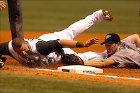 Pinellas, St Pete, Fl. 8/1/2007--ART-RAYS02-- Tampa Bay Devil Rays Jonny Gomes (31) slides safe into third base as Toronto Blue Jays Josh Towers (7) can't apply the tag Wednesday August 1, 2007 at Tropicana Field in St Petersburg. PHOTOS 9 OF IMAGES STAFF MS