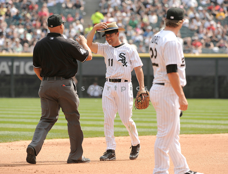 OMAR VIZQUEL, of the Chicago White Sox , in actions during the White Sox game against the Tampa Bay Rays  at US Cellular Field on April 10, 2011.  The Chicago White Sox won the game beating the Tampa Bay Rays 6-1.