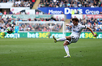 Tom Carroll of Swansea City crosses the ball into the box during the Premier League match between Swansea City and Middlesbrough at The Liberty Stadium, Swansea, Wales, UK.