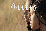 Twin sisters portrait in profile, braided hair, Manitoba prairie grasses in background.  High school seniors portrait.