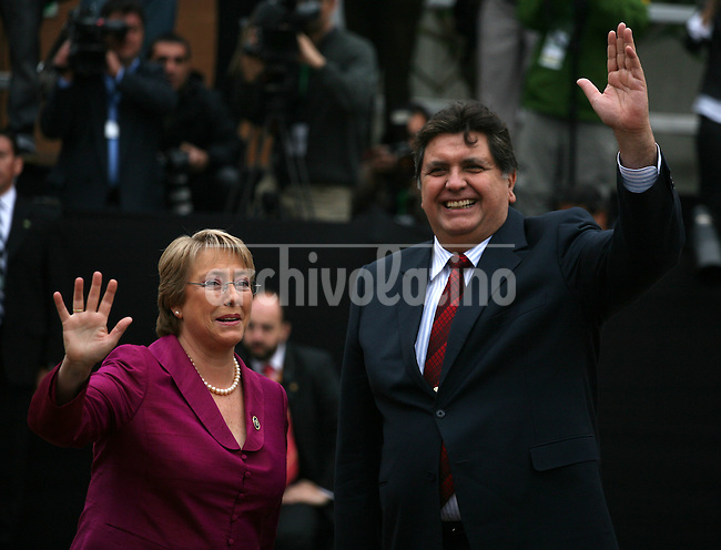 President of Chile Michelle Bachelet and President  of Peru Alan Garcia, wave before the first session of the XVII Iberoamerican Summit in Santiago de Chile