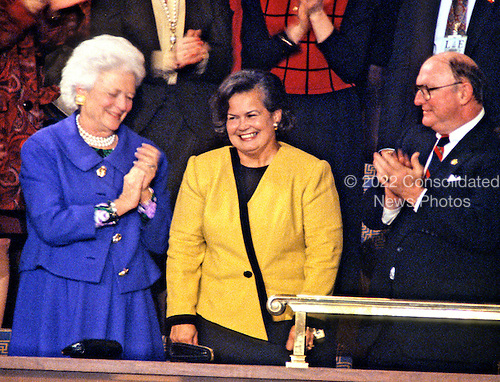 First lady Barbara Bush, left, and White House Press Secretary Marlin Fitzwater, right, applaud Mrs. Norman Schwarzkopf (Brenda), center, as she is recognized by United States President George H.W. Bush as he delivers his State of the Union Address to a Joint Session of the 102nd U.S. Congress in the U.S. Capitol in Washington, D.C. on January 29, 1991.<br /> Credit: Ron Sachs / CNP