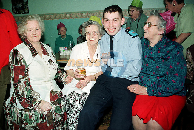 Kathleen Cunningham Bridie Tracey andc Peg Tarrent with one of the Trainee gards at the Garda Sponsored Old Folks Party in Drogheda Community Services Centre..Pictures Fran Caffrey Newsfile