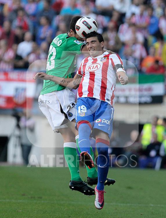 Atletico de Madrid's Jose Antonio Reyes (r) and Getafe's Marcano during La Liga match.October 16,2010. (ALTERPHOTOS/Acero)