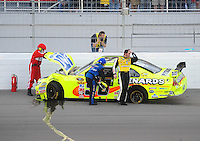Mar. 1, 2009; Las Vegas, NV, USA; NASCAR Sprint Cup Series driver Paul Menard (98) walks away from his car after crashing during the Shelby 427 at Las Vegas Motor Speedway. Mandatory Credit: Mark J. Rebilas-