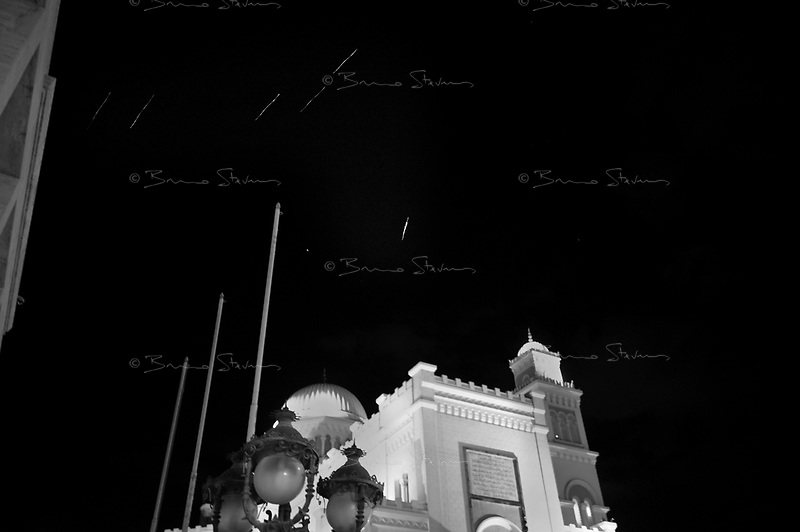 Tripoli, Libya, March 22, 2011.Anti-aircraft tracers in the sky over the mosque on Algeria square during a coalition air strike.