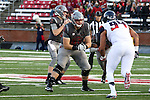 Noah Osur-Myers, Washington State offensive lineman, drops back in to pass protection during the Cougars Pac-12 Conference demolition of the Arizona Wildcats, 69-7, on November 5, 2016, at Martin Stadium in Pullman, Washington.