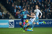Jordan Turnbull of Coventry City tackles Scott Kashket of Wycombe Wanderers during the The Checkatrade Trophy - EFL Trophy Semi Final match between Coventry City and Wycombe Wanderers at the Ricoh Arena, Coventry, England on 7 February 2017. Photo by Andy Rowland.