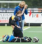 DEN BOSCH - HOCKEY -   Landkampioenschap jeugd  tussen HDM MA1 en Amsterdam MB1. Amsterdam wordt Kampioen (0-1) . blessure voor keeper Anke van Goudoever (HDM). . COPYRIGHT KOEN SUYK