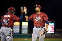 Lehigh Valley IronPigs outfielder Aaron Altherr (27) high fives pitching coach Ray Burris (34) after a game against the Rochester Red Wings on July 4, 2015 at Frontier Field in Rochester, New York.  Lehigh Valley defeated Rochester 4-3.  (Mike Janes/Four Seam Images)