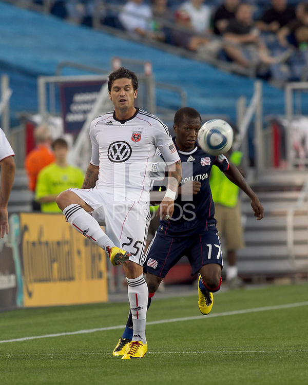 DC United midfielder Santino Quaranta (25) redirects a throwin as New England Revolution midfielder Sainey Nyassi (17) defends. The New England Revolution defeated DC United, 1-0, at Gillette Stadium on August 7, 2010.