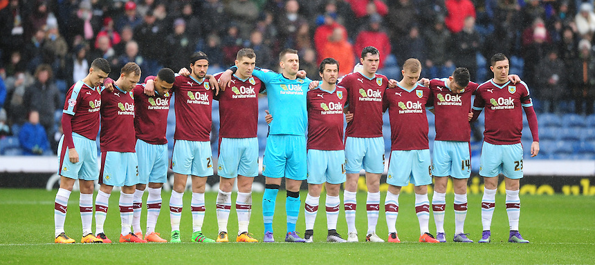 Burnley players observe a minutes silence in memory of Ray Pointer and Frank Teasdale<br /> <br /> Photographer Chris Vaughan/CameraSport<br /> <br /> Football - The Football League Sky Bet Championship - Burnley v Hull City - Saturday 6th February 2016 - Turf Moor - Burnley <br /> <br /> &copy; CameraSport - 43 Linden Ave. Countesthorpe. Leicester. England. LE8 5PG - Tel: +44 (0) 116 277 4147 - admin@camerasport.com - www.camerasport.com