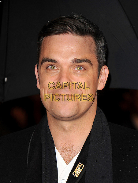 ROBBIE WILLIAMS.Arrivals the Brit Awards 2010 held at Earls Court, London, England..February 16th 2010 .Brits headshot portrait black.CAP/BEL.©Tom Belcher/Capital Pictures.