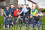 Community Garda Tricia Fitzpatrick gets on her bike at the launch of the annual Kerry emergency services cycle, which will be held in Killarney on 9th June, in Farranfore Garda Station on Wednesday evening was front l-r: Claire Spillane, Grace Murray both Kerry Stars, Claude O'Connor HSE. Back row: William Murray Kerry Stars, John Spillane Kerry Stars, Suzanne Scully Organising Committee, Pat Fleming Fire Service, Community Garda Tricia Fitzpatrick, John O'Donnell Fire Service and Geraoid Constable HSE Ambulance..