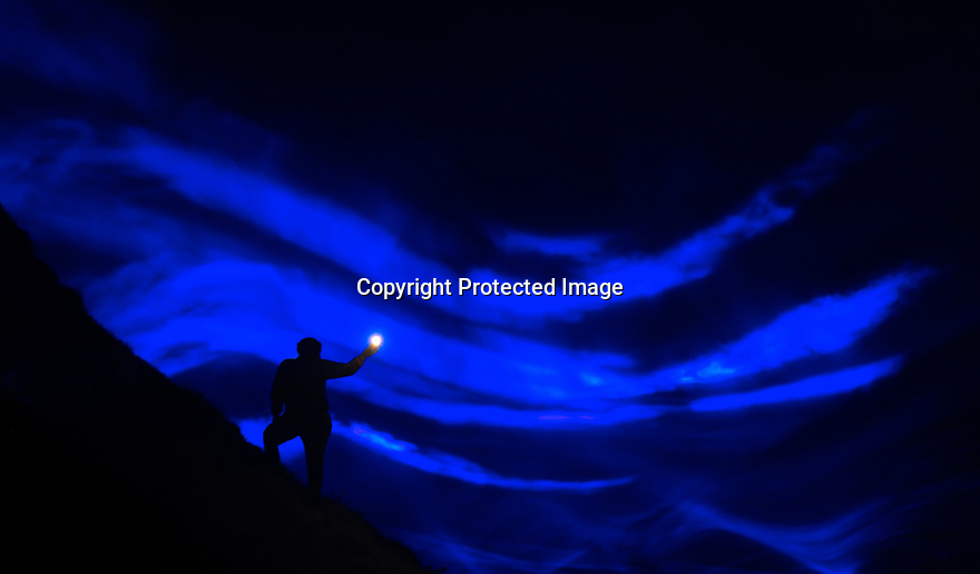 22/09/17<br /> <br /> Winatts Pass - a steep-sided gorge located high up in the  Peak District - is illuminated using  blue lasers and smoke as artist Daan Roosegaarde re-imagines how the pass would look if water and waves once again flowed between the hillsides. WATERLICHT is the showcase installation for the Abandon Normal Devices (AND) festival where artists will exhibit in many other locations down mines and inside caves in the Derbyshire town of Castleton from Thu 21st to Sat 23rd Sep 2017<br /> each evening from 7pm to 11pm.<br /> <br /> Press release: <br /> <br /> Set in the dramatic v-shaped valley of Winnats Pass that acts as a gateway into Castleton and the Hope Valley, WATERLICHT will virtually flood Winnats Pass with light and smoke to reveal the geological formations of the site and its history as a valley once submerged under a tropical sea. Stretching back into the times of the Ice Age, when glacial rivers carved the landscape, WATERLICHT will visualise how high the water level could reach without human intervention. Created using the latest LED technology, software and lenses, audiences will be able to see historical water levels.<br /> <br /> Bring your devices and headphones for a fully immersive experience. The work will be accompanied by a newly commissioned soundscape that looks to the fascinating geology and heritage of the site and its relationship with water.<br /> All Rights Reserved: F Stop Press Ltd. <br /> <br /> +44(0)1773 550665  www.fstoppress.com.