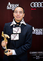 HONG KONG - MARCH 21:  Thai director Apichatpong Weerasethakul poses backstage after winning the Best Film Award for his film 'Unicle Boonmee Who Can Recall His Past Lives' at the 5th Asia Film Awards ceremony at the Convention and Exhibition Centre on March 21, 2011 in Hong Kong, China.  Photo by Victor Fraile / studioEAST