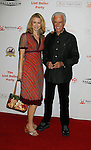 HOLLYWOOD, CA. - October 03: Robert Culp (R) and Elisabeth Granli arrive at the Best Friends Animal Society's 2009 Lint Roller Party at the Hollywood Palladium on October 3, 2009 in Hollywood, California.