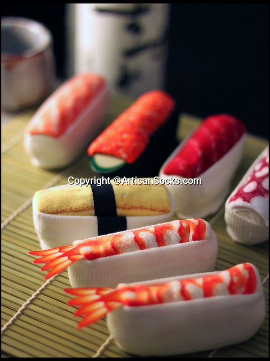 BNPS.co.uk (01202 558833)<br /> Pic: ArtisanSocks/BNPS<br /> <br /> ***Must Use Full Byline***<br /> <br /> Soft Sushi Shuffle...<br /> <br /> The selection of sushi socks. <br /> <br /> Now, should you wish to, you can make your sock draw look like a sushi bar.<br /> <br /> These morsels of mouthwatering sushi might look tantalising but you wouldn't want to eat them - because they're actually rolled up socks.<br /> <br /> The super-realistic items of clothing are the latest bizarre trend sweeping the fashion world and have been an instant hit with shoppers.<br /> <br /> Unrolled they look like any other sock but rolled up they form seven different varieties of the raw fish snack, transforming your underwear drawer into a smorgasbord of sushi.<br /> <br /> The life-like 'flavours' include egg (tamago), salmon roe (ikura), shrimp (ebi), octopus (tako), tuna (maguro ), salmon (sa-mon) and trout (masuzishi).<br /> <br /> Sushi socks cost $6 a pair - around £3.70 - and can be bought from artisansocks.com.