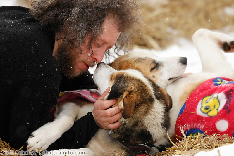 Sebastian Schnuelle gives kisses, pets and hugs to his dogs Gas and Diesel at Takotna on Wednesday afternoon  Iditarod 2009