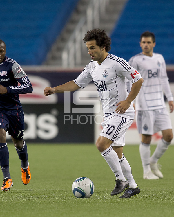 Vancouver Whitecaps FC midfielder Davide Chiumiento (20) at midfield. In a Major League Soccer (MLS) match, the New England Revolution defeated the Vancouver Whitecaps FC, 1-0, at Gillette Stadium on May14, 2011.