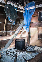 Cooking pot in a traditional Batak House, Lake Toba (Danau Toba), North Sumatra, Indonesia