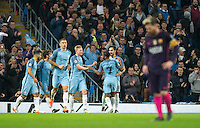 Ilkay Gundogan (right) of Manchester City celebrates with Raheem Sterling of Manchester City and teammates as Lionel Messi of Barcelona walks in disappointment during the UEFA Champions League match between Manchester City and Barcelona at the Etihad Stadium, Manchester, England on 1 November 2016. Photo by Andy Rowland / PRiME Media Images.