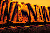 Row of identical Box Cars shot at sundown. Houston Texas USA Inglewood Yard.