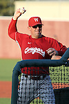 Washington State University head baseball coach, Donnie Marbut, throws batting practice during a Cougar practice at Bailey-Brayton Field in Pullman, Washington, on September 10, 2010.