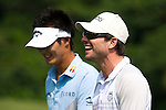 HAIKOU, CHINA - OCTOBER 30:  Danny Lee of New Zealand and Christian Slater of USA laugh on the 5th hole during day four of the Mission Hills Start Trophy tournament at Mission Hills Resort on October 30, 2010 in Haikou, China. The Mission Hills Star Trophy is Asia's leading leisure liflestyle event and features Hollywood celebrities and international golf stars. Photo by Victor Fraile / The Power of Sport Images