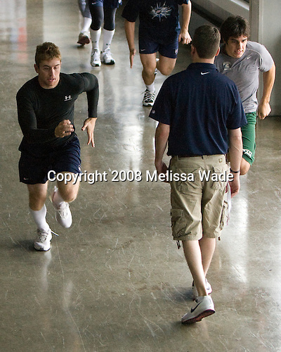 David Warsofsky (US White - 3), Jason Hodges, Corey Tropp (US White - 19) - Members of US Team White warmup on the concourse of the 1980 Rink prior to their game against the Swedes on Friday, August 8, 2008, during the 2008 US National Junior Evaluation Camp and Summer Hockey Challenge in Lake Placid, New York.