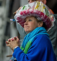 LOUISVILLE, KY - MAY 05: A fan uses a poncho to protect her hat from the rain on Kentucky Oaks Day at Churchill Downs on May 5, 2017 in Louisville, Kentucky. (Photo by Jesse Caris/Eclipse Sportswire/Getty Images)