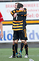 Alloa's Andy Kirk is congratulated by Kevin Cawley (7) after he scores their second goal.