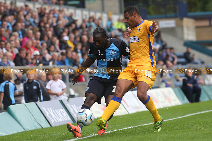 Marvin McCoy of Wycombe & Mansfield's Ben Hutchinson - Wycombe Wanderers vs Mansfield Town - Sky Bet League Two Football at Adams Park, High Wycombe - 17/08/13 - MANDATORY CREDIT: Paul Dennis/TGSPHOTO - Self billing applies where appropriate - 0845 094 6026 - contact@tgsphoto.co.uk - NO UNPAID USE