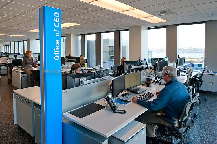 "1/30/2012--Seattle, WA, USA..The CEO office at Russell Investments (empty desk in right corner of floor); the office is an open desk  designated only by a glowing ""Office of CEO"" sign. The company's offices, on floors 14-18 in the former Washington Mutual tower in downtown Seattle, WASH., are designed with a totally non-hierarchical environment: there are no private offices for its 1,000 employees.  ..NBBJ, a Seattle-based architecture firm with global reach, has been creating office environments with concepts such as open, non-hierarchical workspaces, nodes designed for casual, unscheduled meetings, and a variety of environments where employees are free to roam and work from their laptops...©2012 Stuart Isett. All rights reserved."