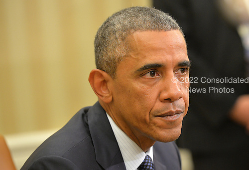 United States President Barack Obama speaks alongside Sylvia Burwell, Secretary of Health and Human Services, as he addresses the media following a meeting with his team coordinating the government's Ebola response, in the Oval Office at the White House in Washington, D.C. on October 16, 2014. Others at the meeting included, Denis McDonough, White House Chief of Staff,  Susan Rice, National Security Advisor, Lisa Monaco, Assistant to the President for Homeland Security and Counterterrorism and Dr. Thomas Frieden, Director of the Centers for Disease Control and Prevention.<br /> Credit: Kevin Dietsch / Pool via CNP