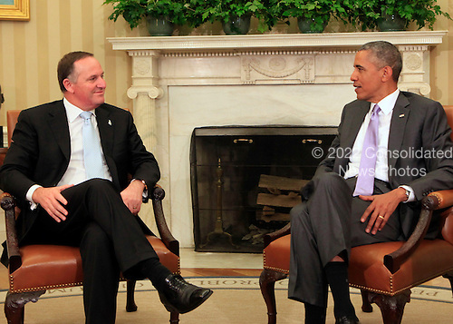 United States President Barack Obama, right, meets with Prime Minister John Key of New Zealand, left, in the Oval Office of the White House in Washington, D.C. on June 20, 2014. <br /> Credit: Dennis Brack / Pool via CNP