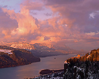 Evening light on snow covered hills in the Columbia River Gorge National Scenic Area, Oregon