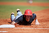 Ball State Cardinals Ross Messina (23) dives back to first base during a game against the Saint Joseph's Hawks on March 9, 2019 at North Charlotte Regional Park in Port Charlotte, Florida.  Ball State defeated Saint Joseph's 7-5.  (Mike Janes/Four Seam Images)