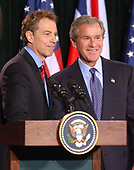 Thurmont, MD - March 27, 2003 -- United States President George W. Bush and British Prime Minister Tony Blair meet reporters at Camp David, Maryland on March 27, 2003 following their talks on the progress of the Iraq War.<br /> Credit: Ron Sachs / Pool via CNP