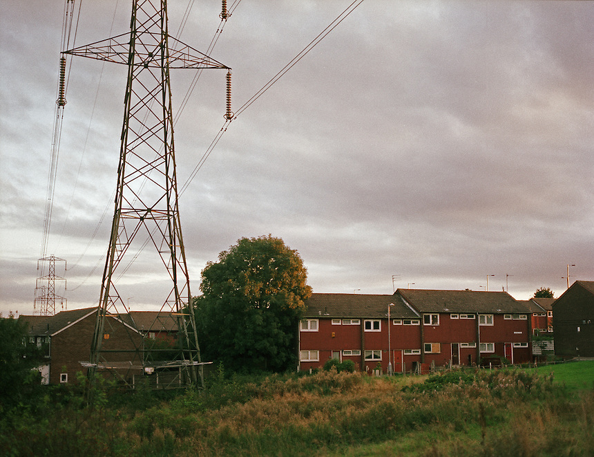 HATTERSLEY, UK - Nestled beneath power lines crossing the Pennines, abandoned homes await demolition to make way for a proposed new Tescos supermarket...The Hattersley Estate was created in the early 1960s to house residents displaced by the slum clearances of inner city Salford and Manchester and soon gained notoreity between 1963 and 1965 as the home to the Moors Murderers, Myra Hindley and Ian Brady. Lying in a relatively isolated area on the edge of the Pennines, residents today continue to wait for the investment and infrastructure promised to them decades ago. In the gap between promise and reality, a unique characted formed during years of adversity continues to thrive on the estate.