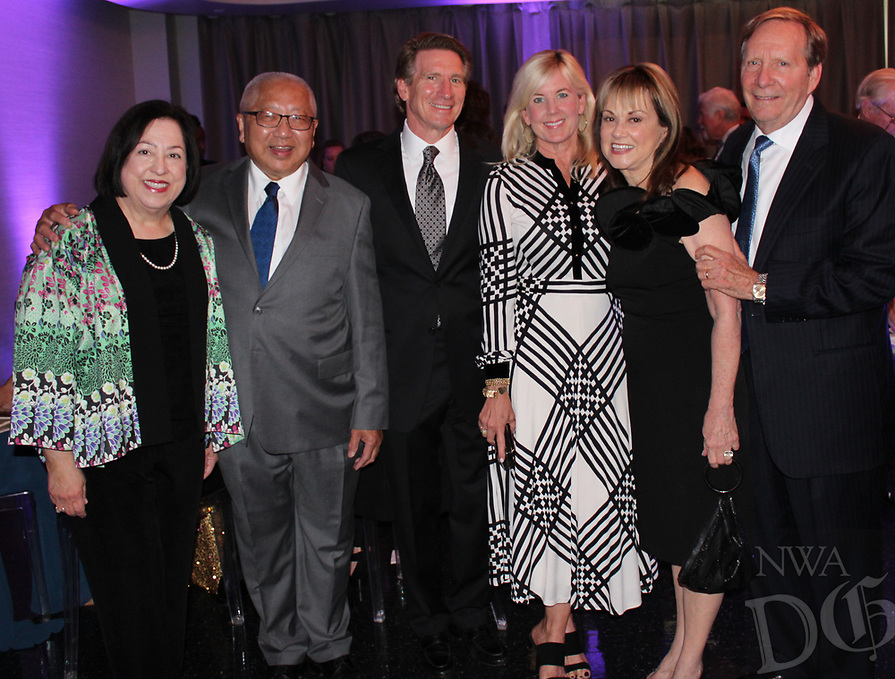 NWA Democrat-Gazette/CARIN SCHOPPMEYER Susan and Dr. Tony Hui (from left); Eagle Award honoree Dr. Scott Bailey and wife Leslie; and Judy and Bill Schwab gather at the Washington Regional Medical Foundation Gala on July 13 at the Walton Arts Center in Fayetteville.
