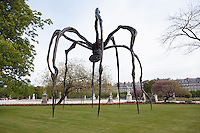 "PARIS, FRANCE -  APRIL 27 :  A low angle view of  ""Maman"" on April 27 2008, in Paris, France. The 9.1 metre high, steel spider is the largest of a series of spider sculptures by Louise Bourgeois, who was born in Paris in 1911 and now lives and works in New York, USA. ""Maman"" was created in 1999. It carries a metal mesh sack of white marble eggs beneath her. The spider has travelled to various cities and is seen here in Paris on a spring morning. (Photo by Manuel Cohen)"