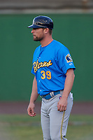 Myrtle Beach Pelicans coach Steven Lerud (39) during a Carolina League game against the Potomac Nationals on August 14, 2019 at Northwest Federal Field at Pfitzner Stadium in Woodbridge, Virginia.  Potomac defeated Myrtle Beach 7-0.  (Mike Janes/Four Seam Images)